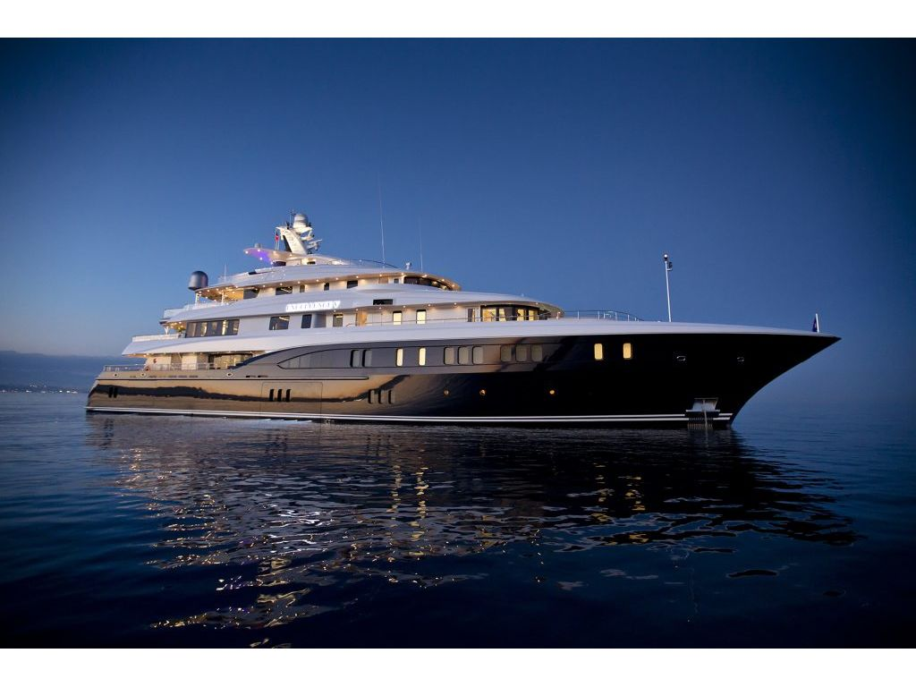 Built by luxury yacht builder ABEKING & RASMUSSEN, EXCELLENCE V measures in at 199.8ft / 60.9m. She has a beam of 42ft, and a draft of 11.1ft. She sleeps up to 14 guests in 7 staterooms and has accommodations for 18 crew. This superryacht is propelled by MTU engines at 2,000 hp each with a maximum speed of 14 knots and a cruising speed of 12 knots. She features a central elevator servicing all five decks, encircled by a dramatic central staircase, a dedicated cinema, a water-front gym, an oversized beach club, a full owner's deck and multiple outdoor lounge areas with spa pools.